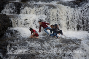 Locals know how to enjoy attractions. Try this in waterfall back home :o)